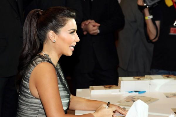 Kim Kardashian Signs Autographs