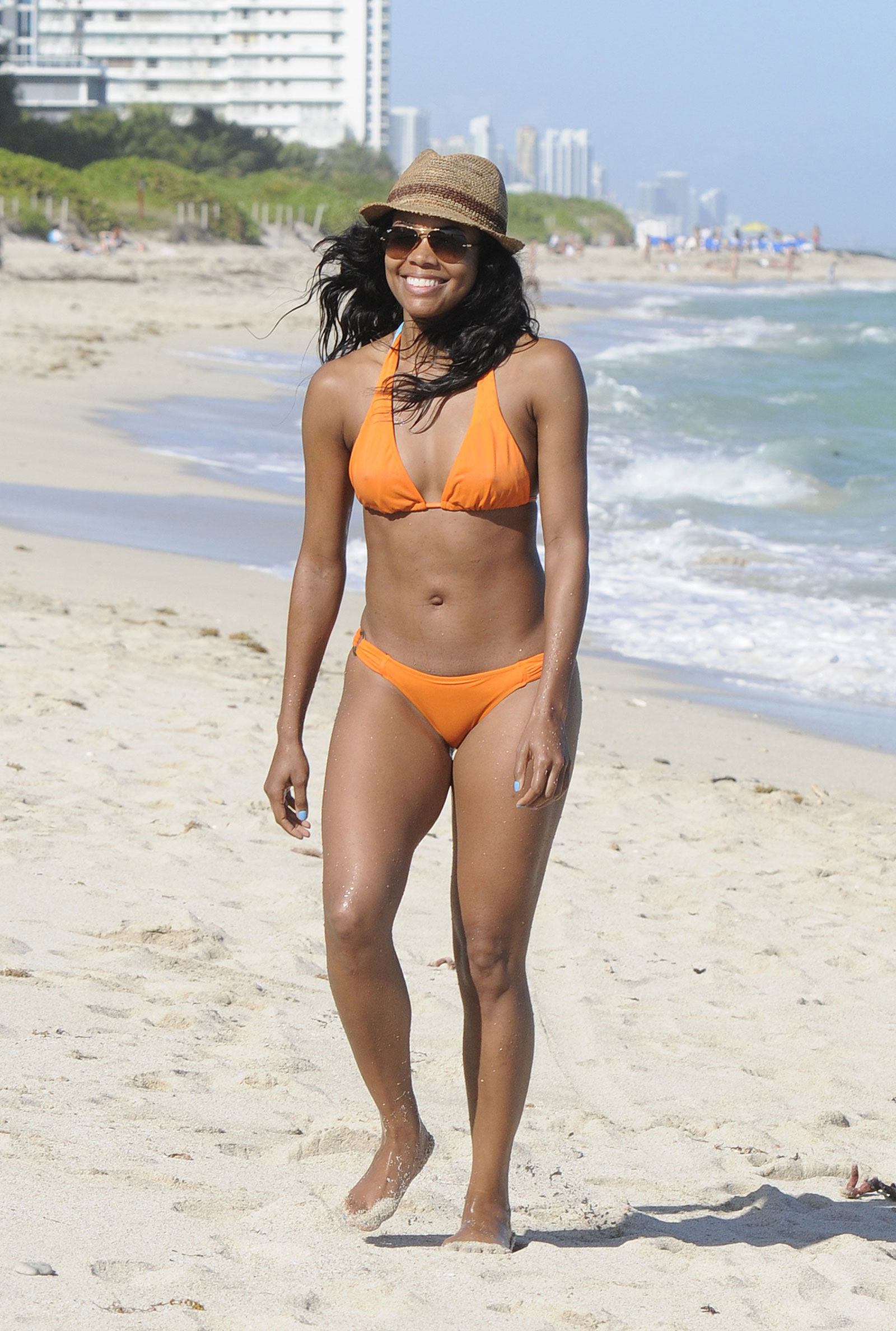 With her slim body and Black hairtype without bra (cup size 32B) on the beach in bikini