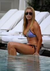 Jill Martin shows of her bikini body in the pool at the Delano Hotel in South Beach