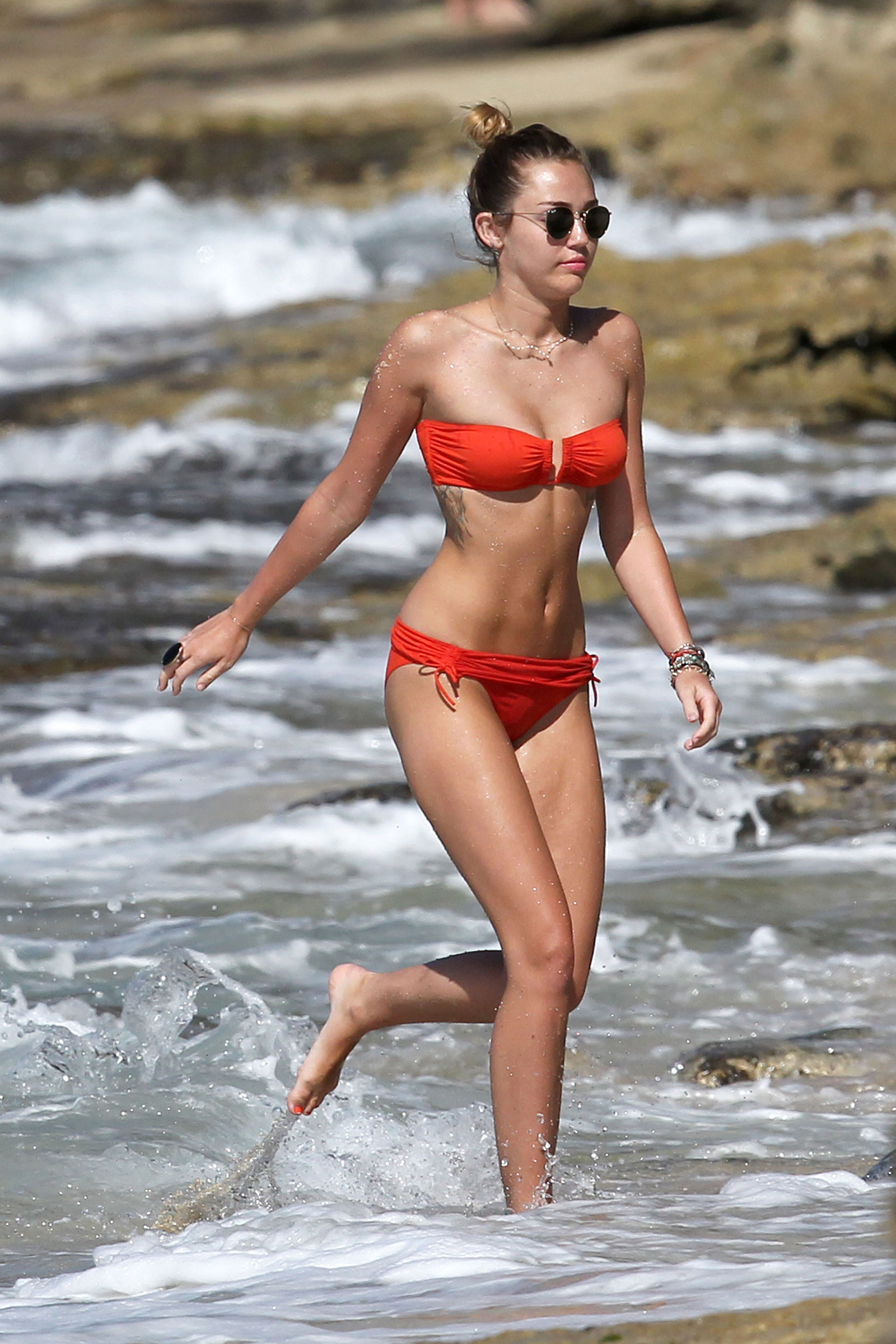 Miley Cyrus Bikini Candids at the Beach in Hawaii - HawtCelebs
