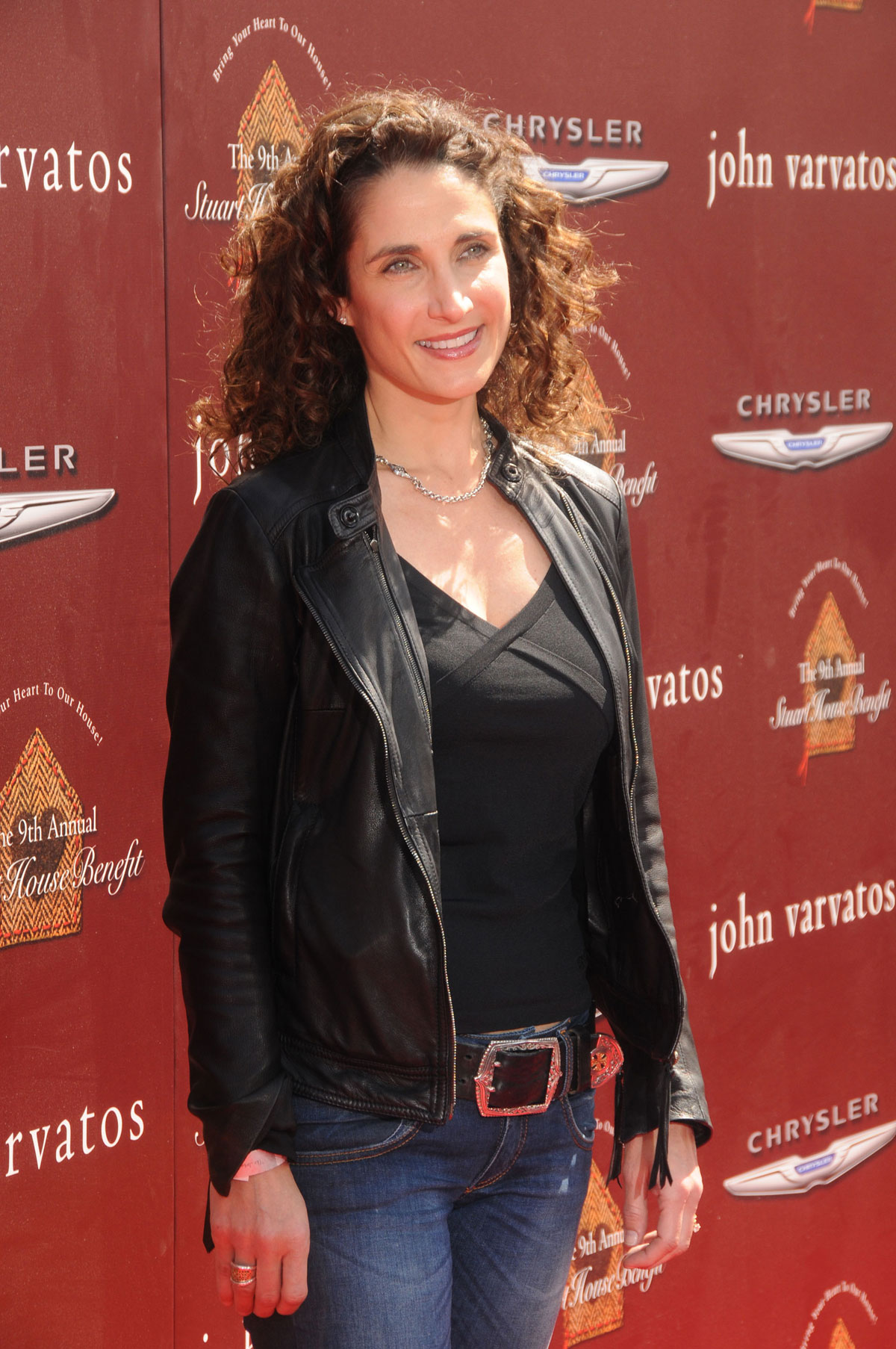 Melina Kanakaredes in leather