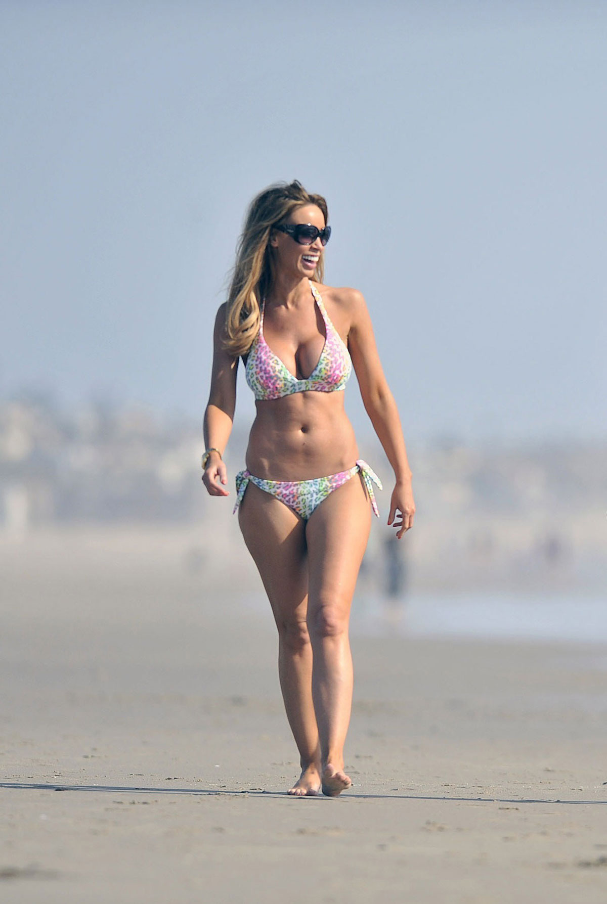 With her slim body and Regular blond hairtype without bra (cup size 34D) on the beach in bikini