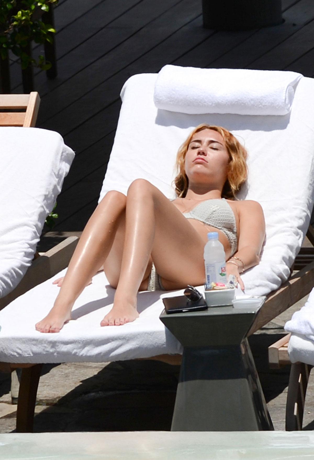 Miley cyrus bikini pool share your