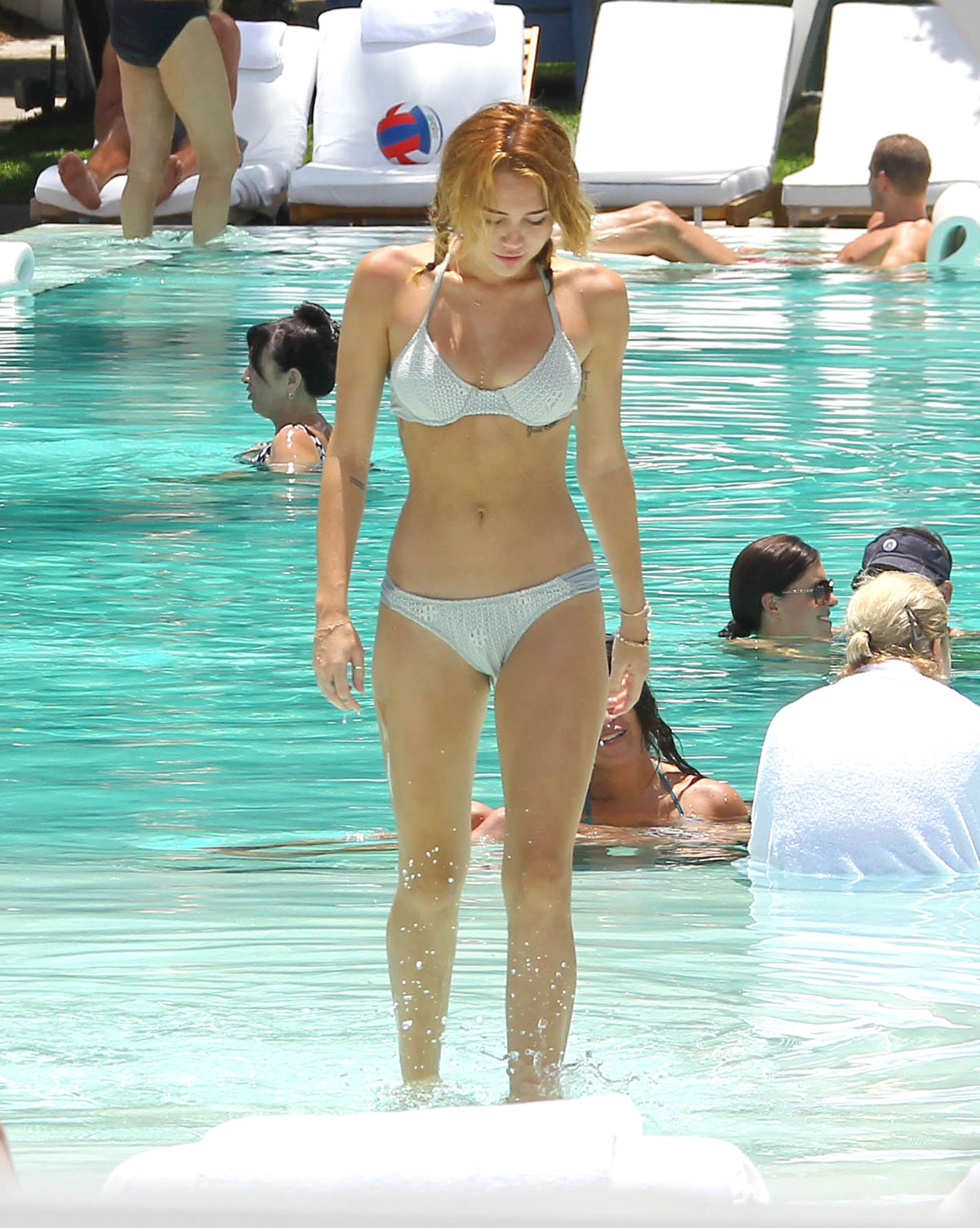 MILEY CYRUS in Bikini at a Hotel Pool in Miami 6 ... uploading porn to some of those digital picture frames at a Target store ...