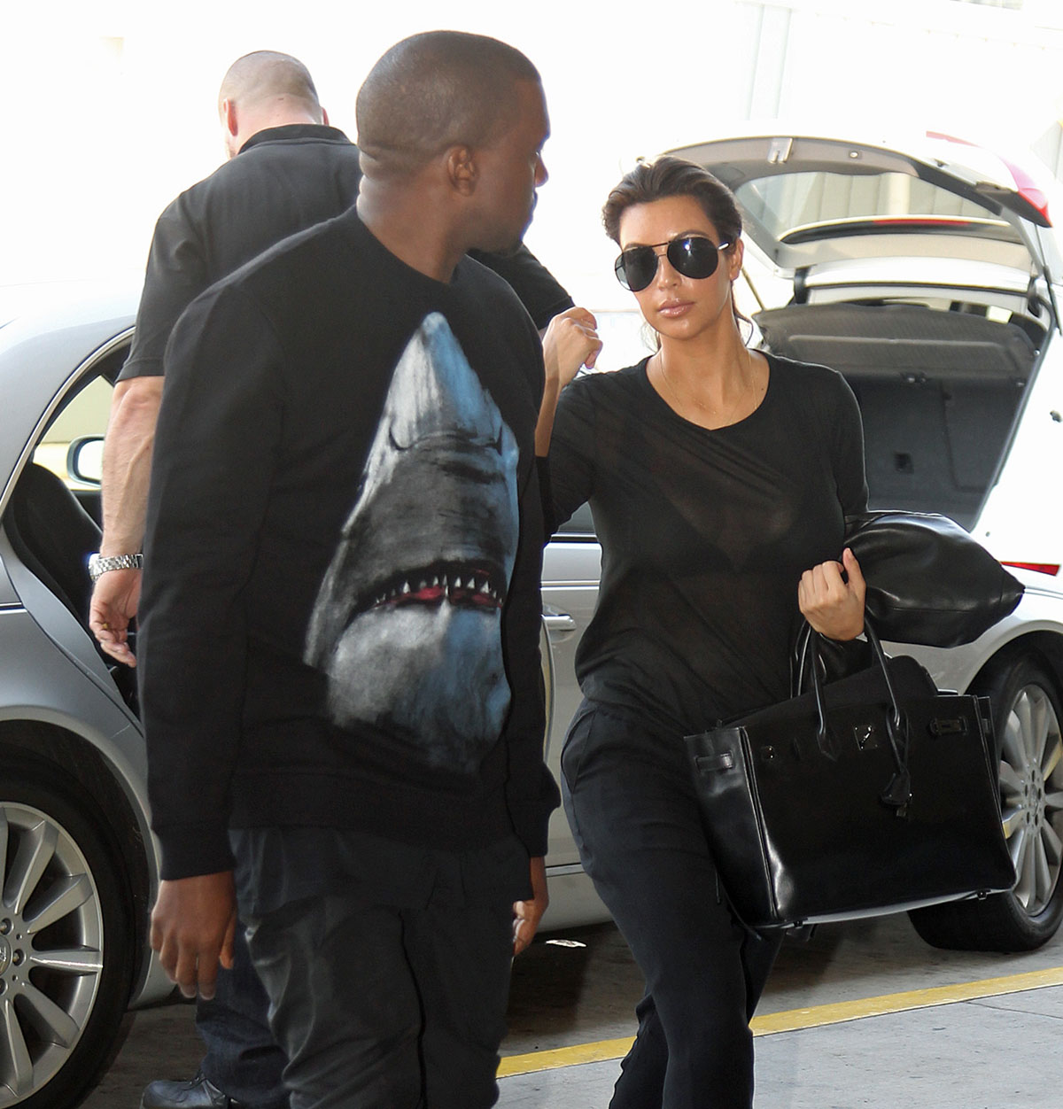 Kim kardashian and kanye west at jfk airport in new york