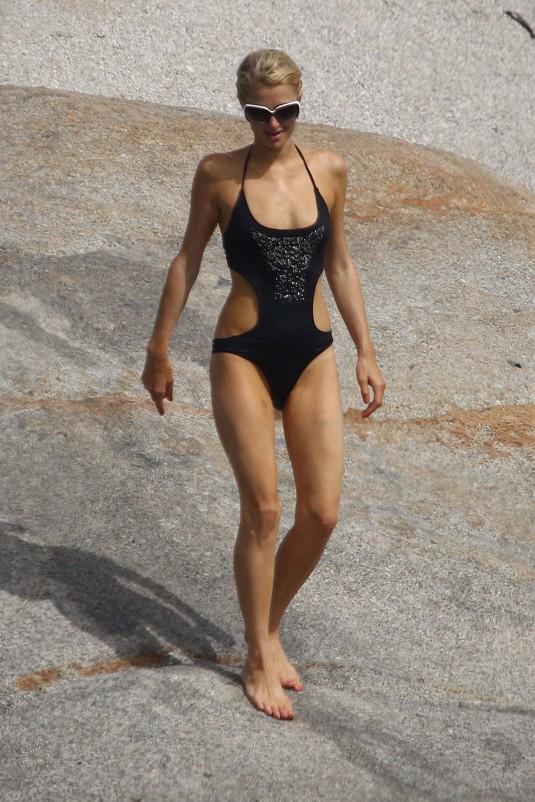 Paris Hilton In Bikini With New Boyfrien At The Beach In France