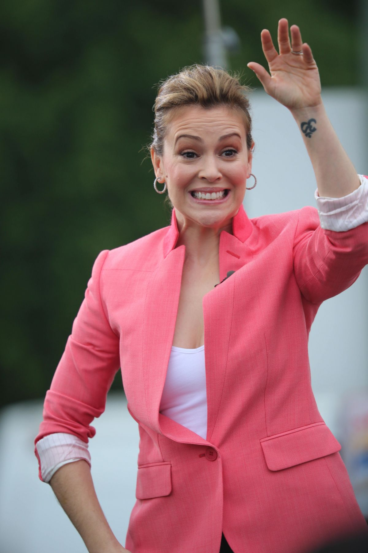 ALYSSA MILANO on the Set of Extra at the Grove in Los Angeles