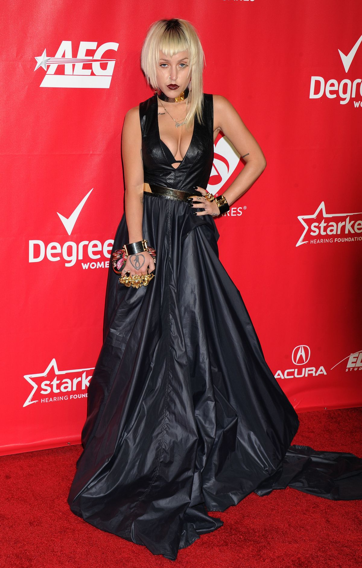 BROOKE CANDY at 2014 Musicares Person of the Year Gala in Los Angeles