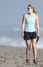 LINDSEY VONN in Shorts Walks Her Dog Leo on the Beach