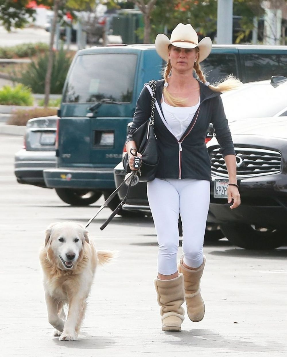 NICOLLETTE SHERIDAN Walks Her Dog Out in Canoga Park