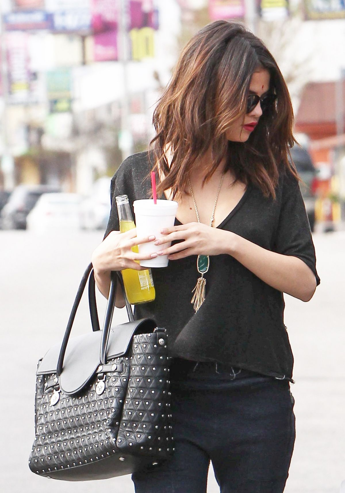 SELENA GOMEZ in Cutout Shirt Out in Los Angeles