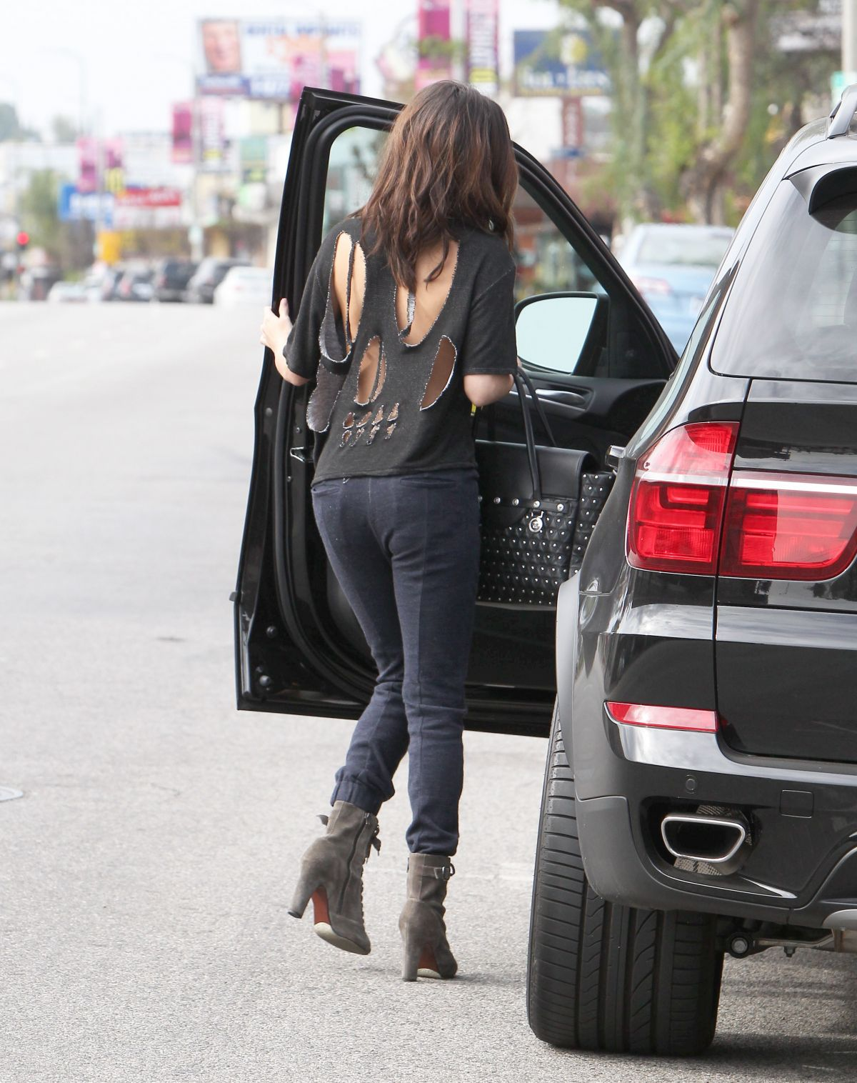 SELENA GOMEZ in Cutout Shirt Out in Los AngelesSelena Gomez No Shirt