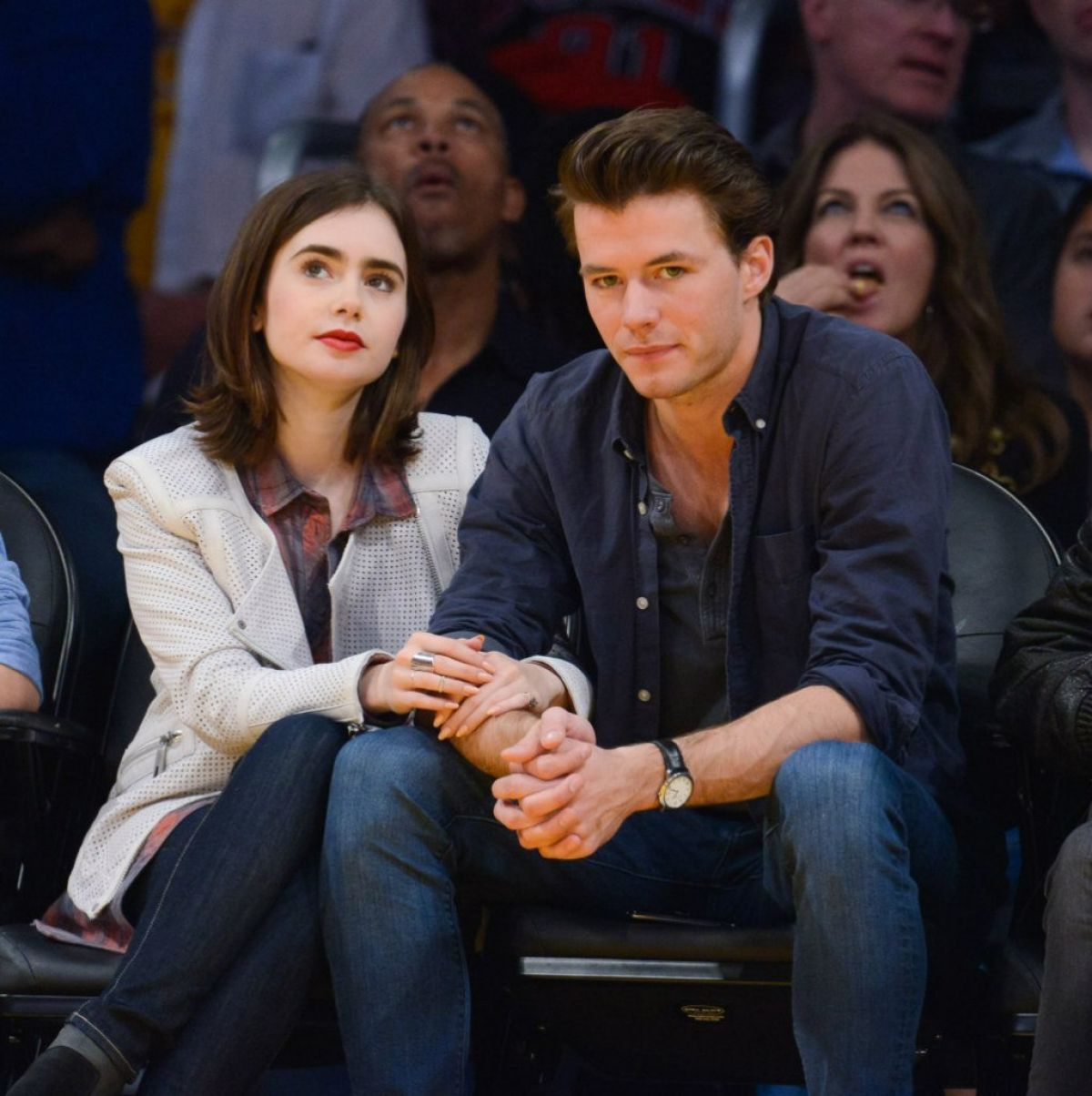 LILY COLLINS and Thomas Cocquerel at Lakers vs Bulls Game in Los Angeles