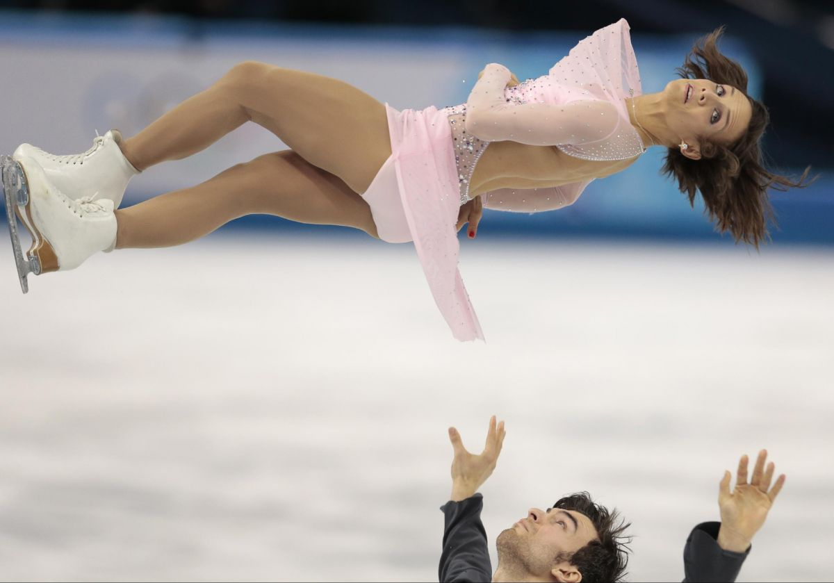 MEAGAN DUHAMEL and Eric Radford at 2014 Winter Olympics in Sochi