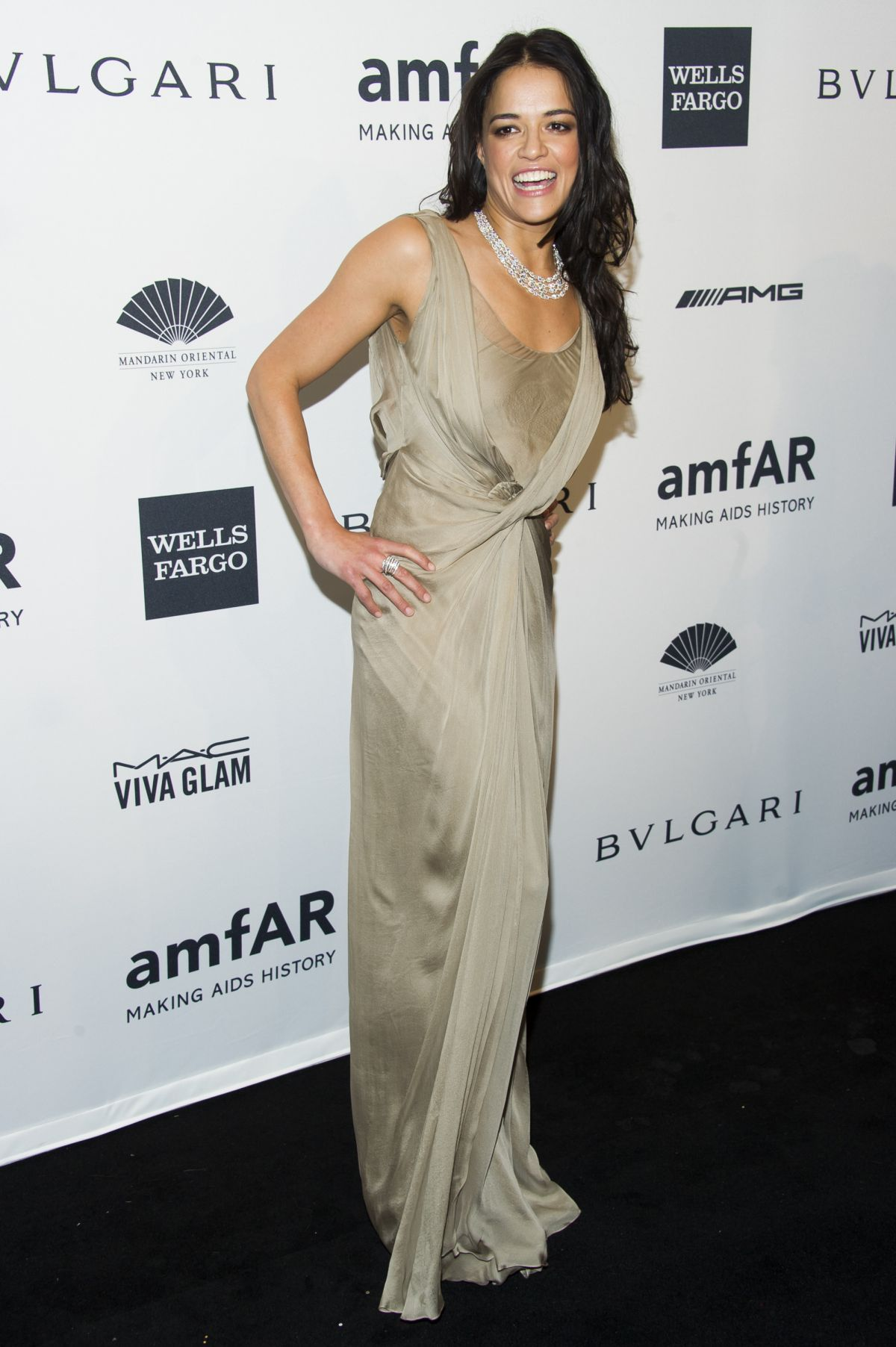 MICHELLE RODRIGUEZ at 2014 AMFAR Gala in New York