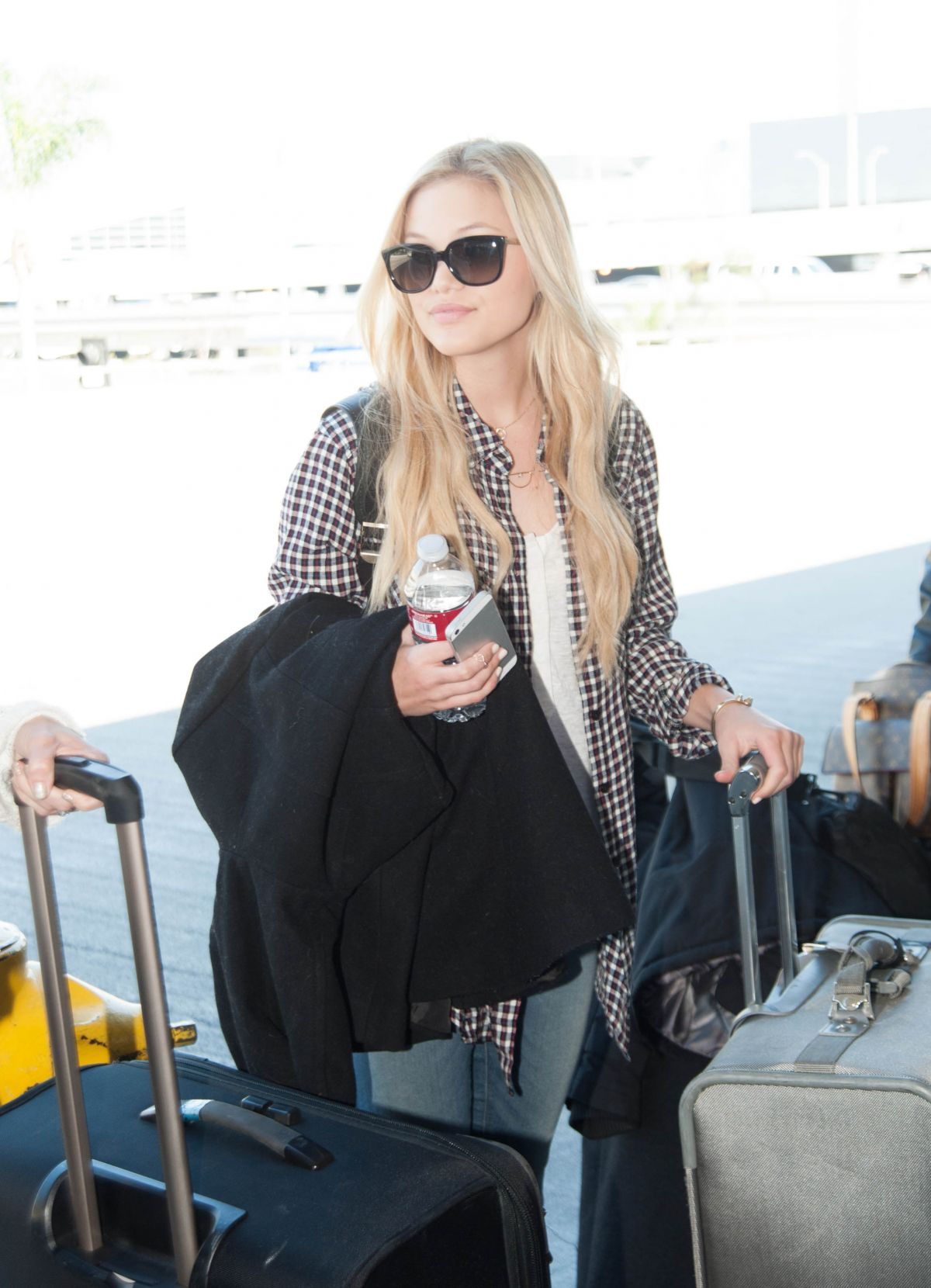 OLIVIA HOLT Arrives at LAX Airport