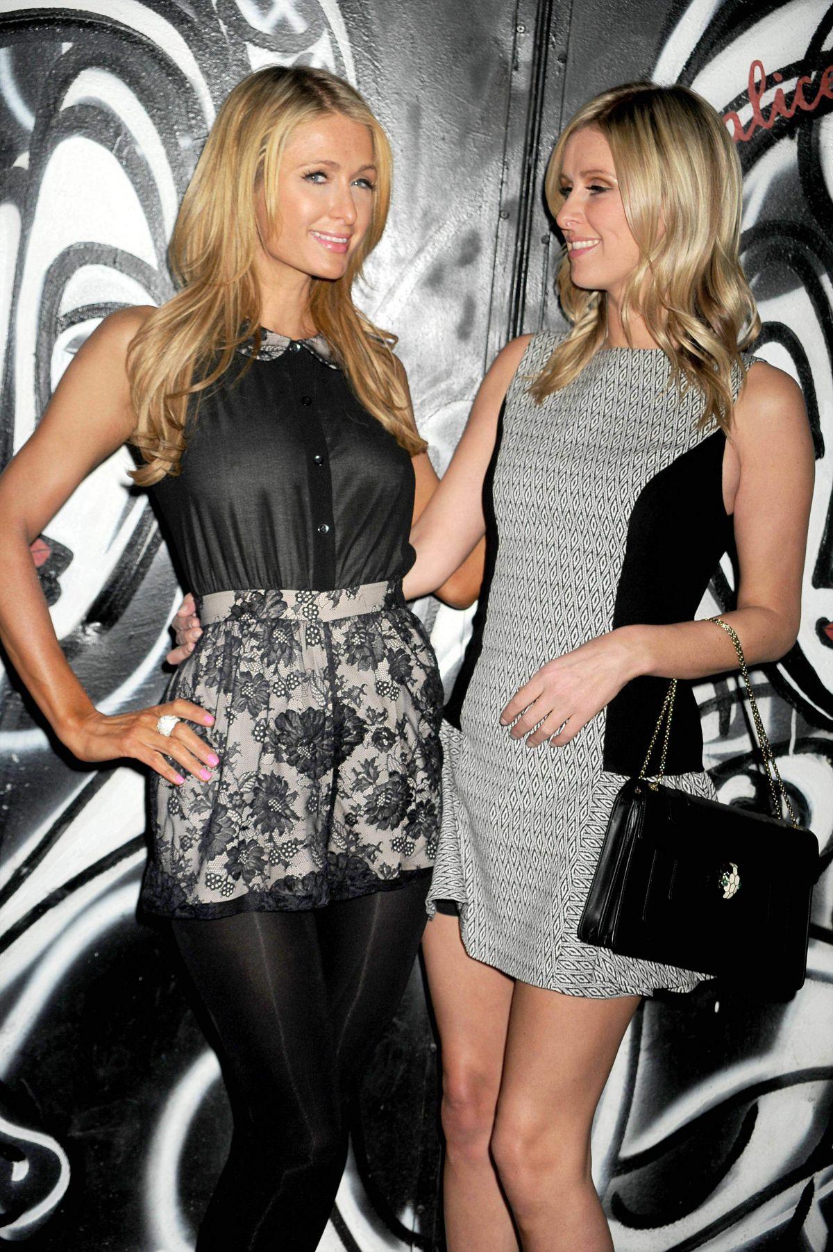 Paris And Nicky Hilton At Alice Olivia Fall 2014 Fashion