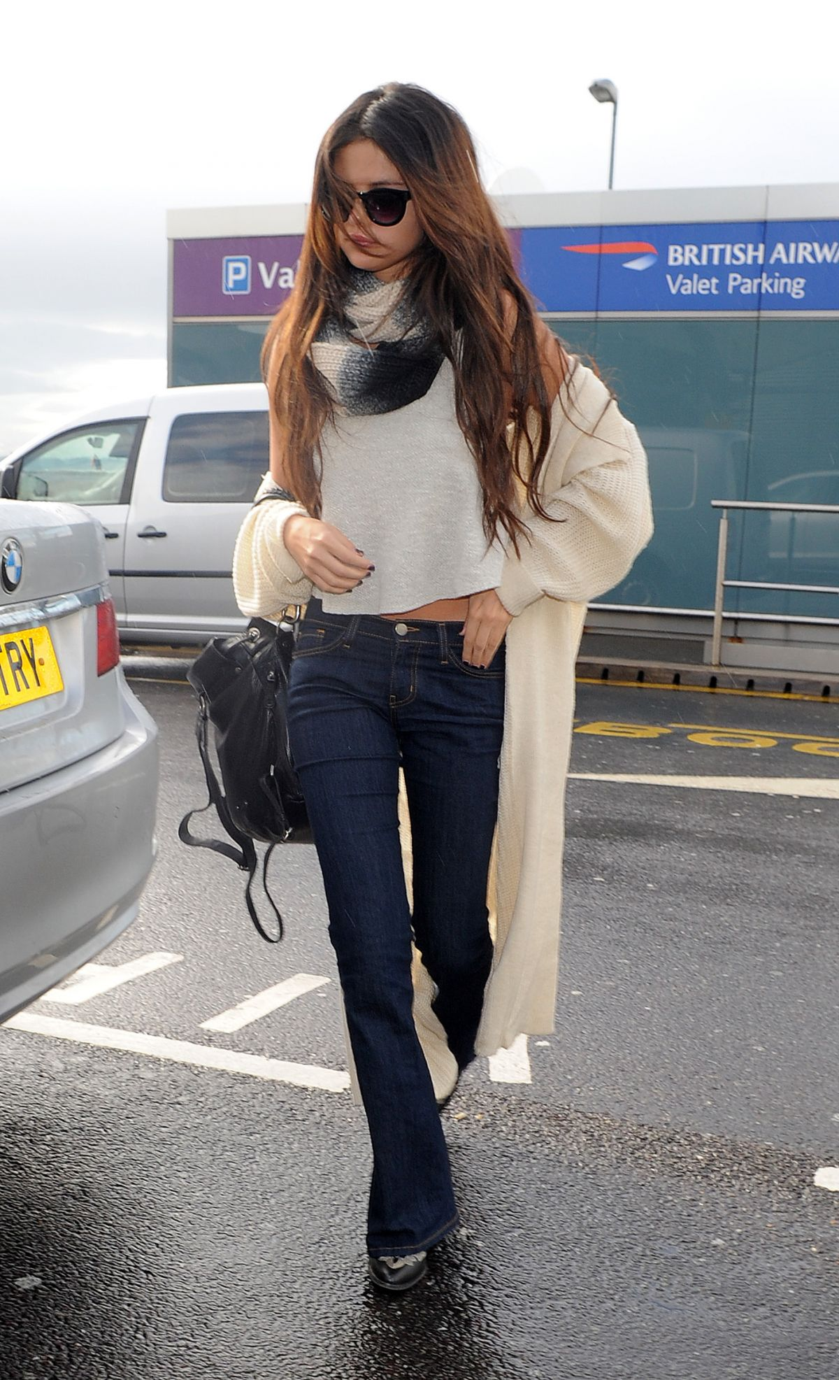 SELENA GOMEZ Arrives at Heathrow Airport in London