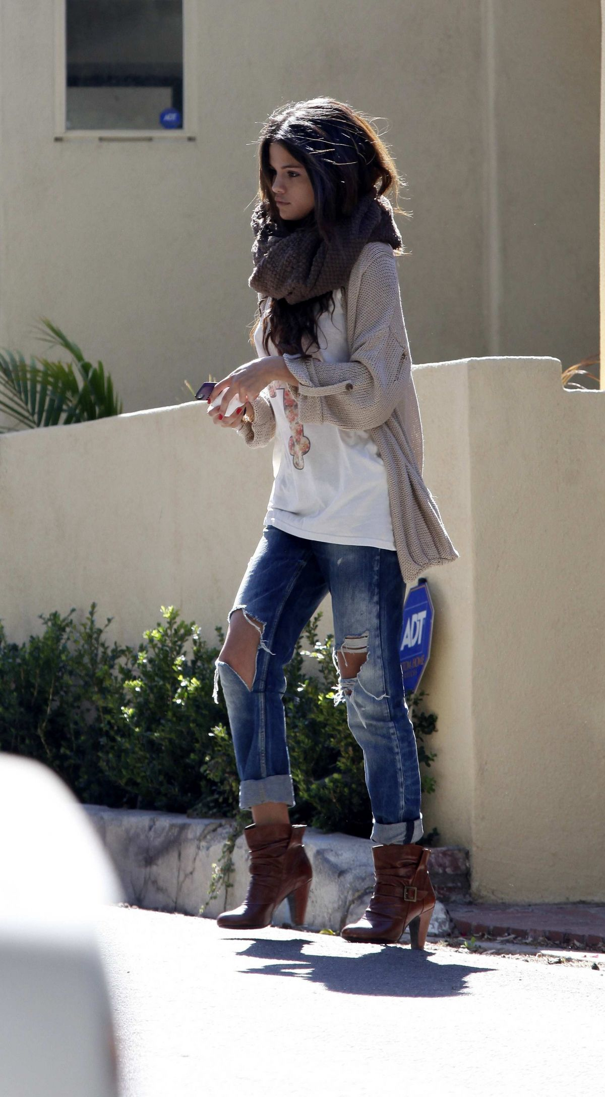 SELENA GOMEZ in Ripped Jeans Out in Los Angeles