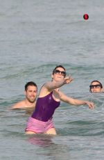 ANNE HATHAWAY in Swimsuit and Shorts in Miami