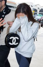 ARIANA GRANDE Arrives at LAX Airport in Los Angeles
