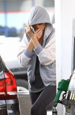 CHARLIEZE THERON at Gas Station after a Yoga Class in Los Angeles