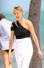 CHARLIZE THERON at a Photoshoot in Miami Beach