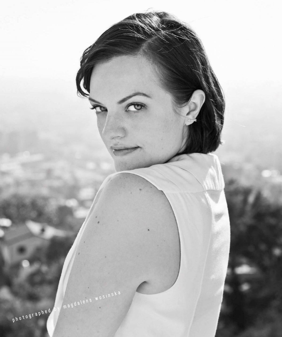 ELISABETH MOSS in Nylon Magazine, April 2014 Issue
