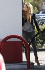 ELIZABETH BERKLEY at a Gas Station in Los Angeles