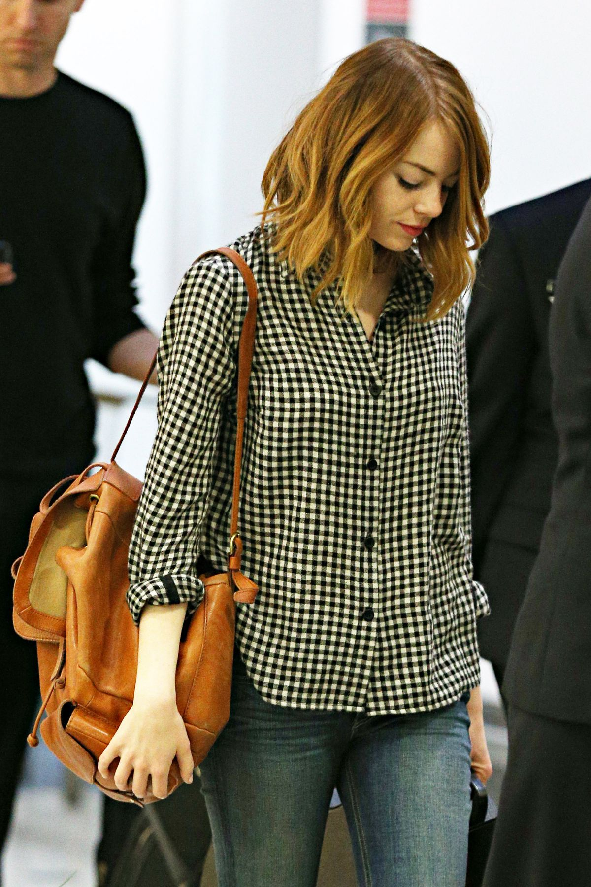 EMMA STONE Arrives at Airport in Sydney