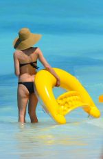 HEIDI KLUM in Bikini at a Beach in Bahamas