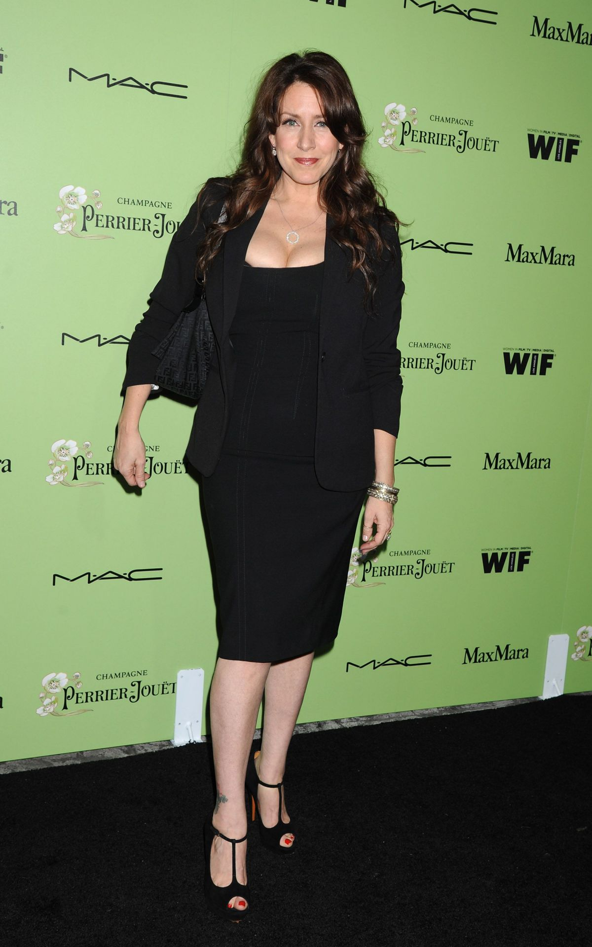 JELY FISHER at Women in Film Pre-oscar Cocktail in West Hollywood