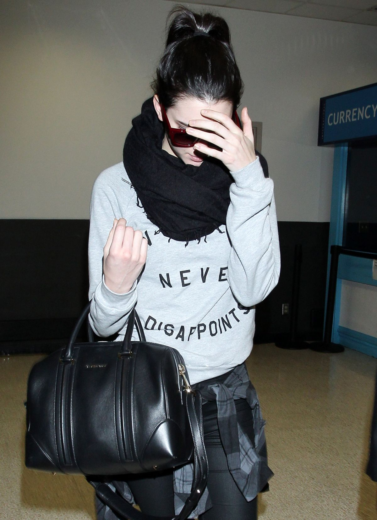 KENDALL JENNER Arrives at LAX in Los Angeles