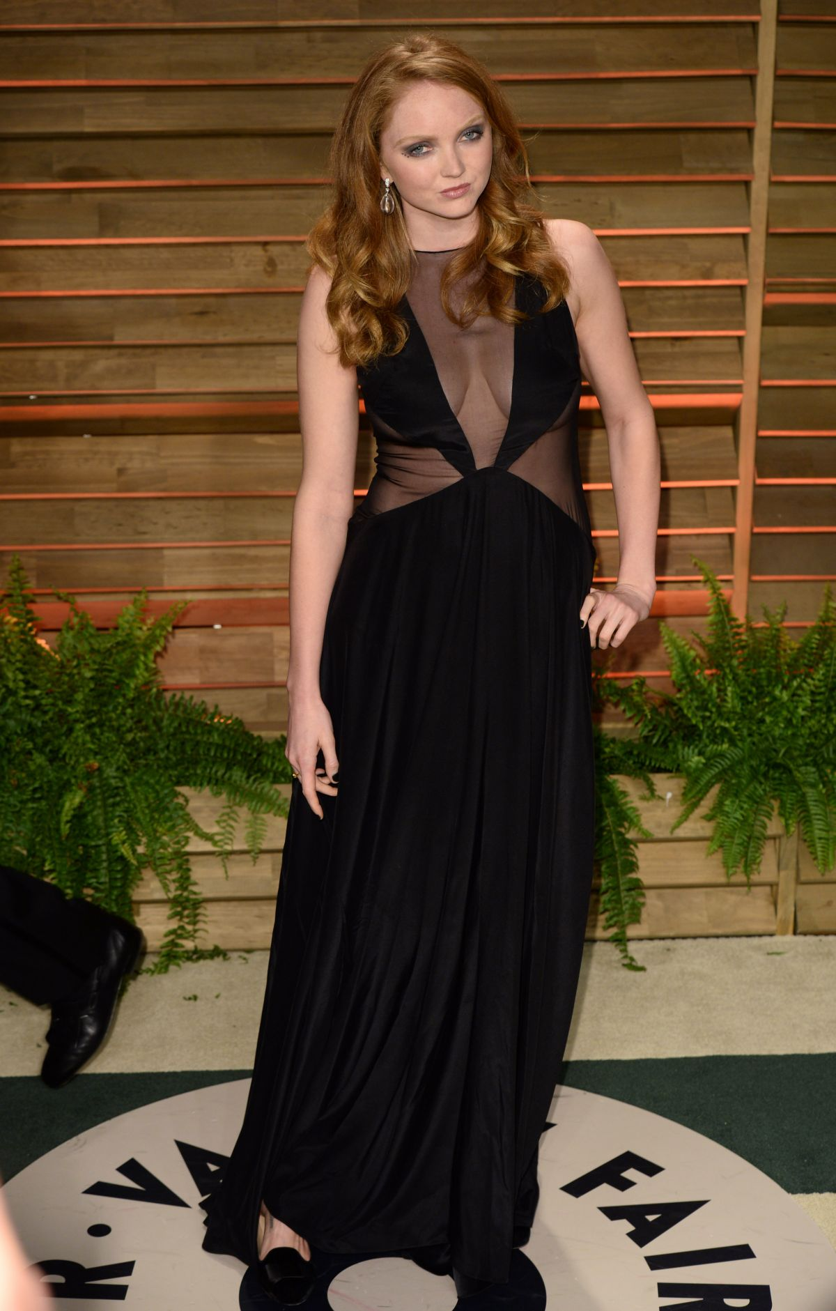 LILY COLE at Vanity Fair Oscar Party in Hollywood