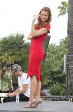 MARIA MENOUNOS in Tight Red Dress on the Set of Extra in Universal City