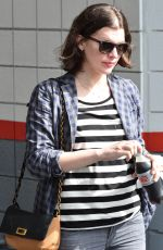 MILLA JOVOVICH Out and About in Los Angeles