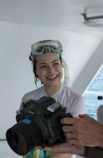 MIRANDA COSGROVE at Oceanup Swimming with Dolphins Campaign