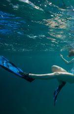 MIRANDA COSGROVE Swiming with Dolphins in Bahamas