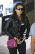 NINA DOBREV in Tights at LAX Airport in Los Angeles 1