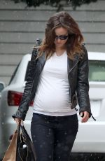 OLIVIA WILDE on a Rainy Day Out in Los Angeles