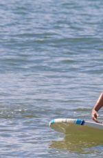 ROSAMUND PIKE in Bikini Paddle Boarding in Hawaii