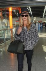 ROSIE HUNTINGTON-WHITELEY Arrives at Heatrow Airport in London