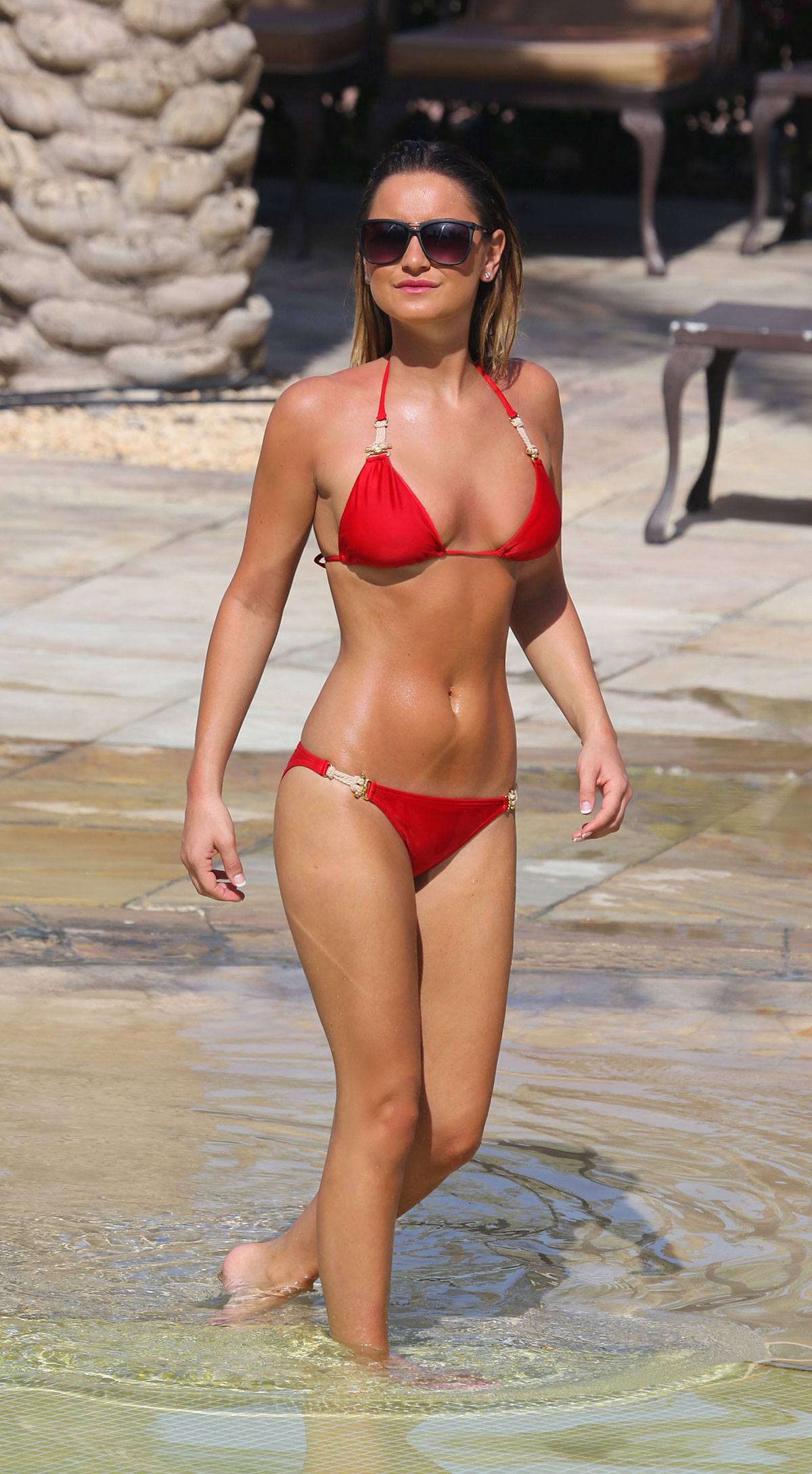 With her slim body and Regular blond hairtype without bra (cup size 32D) on the beach in bikini