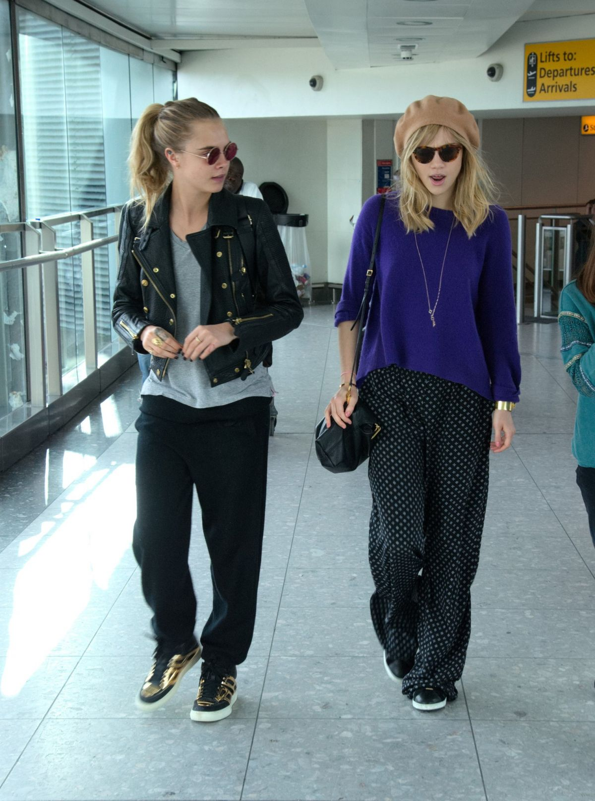 CARA DELEVINGNE and SUKI WATERHOUSE at Heathrow Airport in London ...