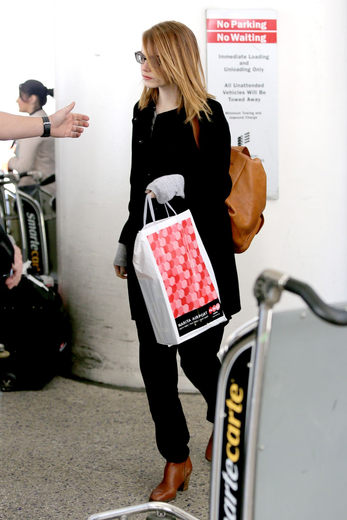 EMMA STONE Arrives at LAX Airport in Los Angeles