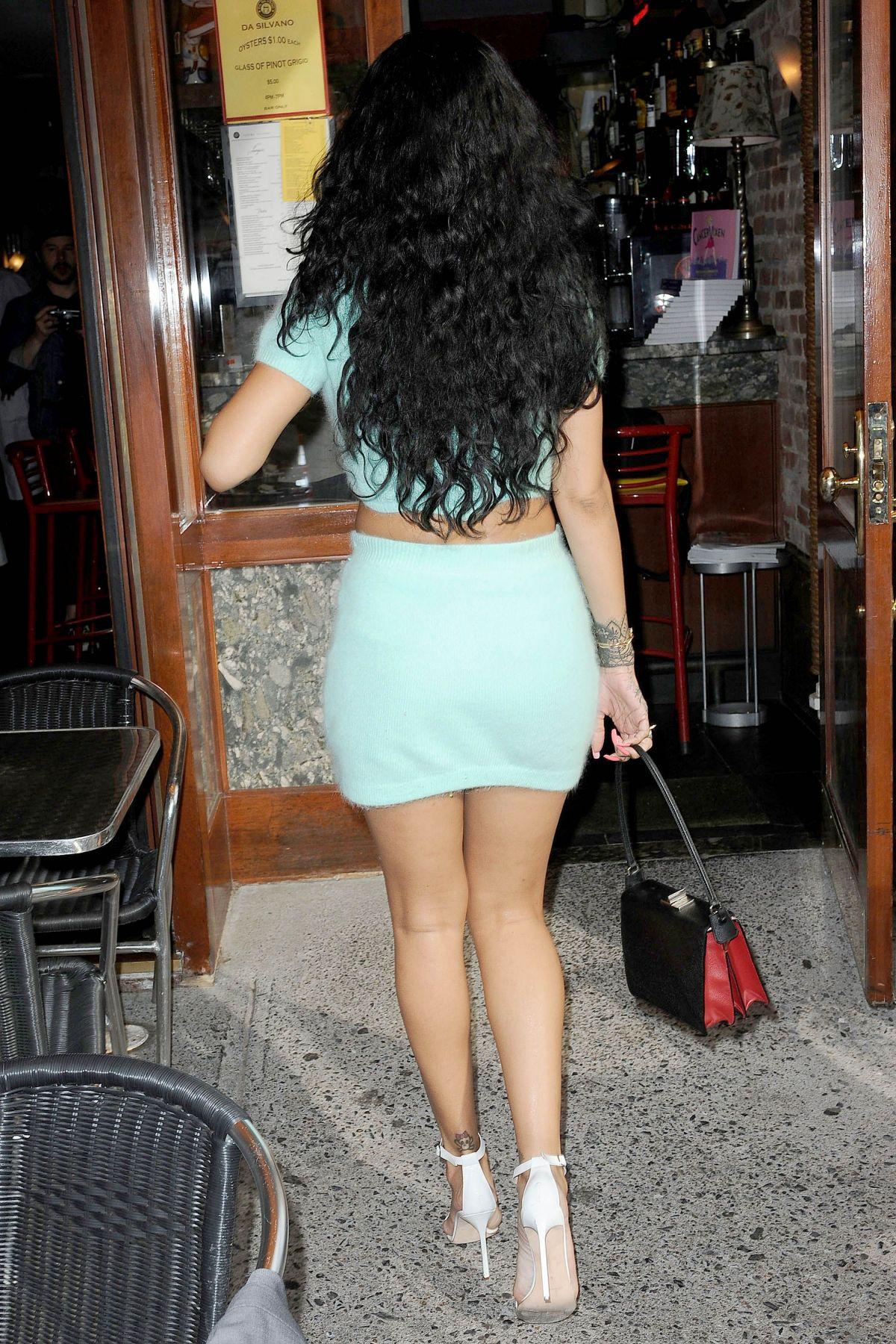 Rihanna glows in yellow skirt for Fenty Beauty NYFW