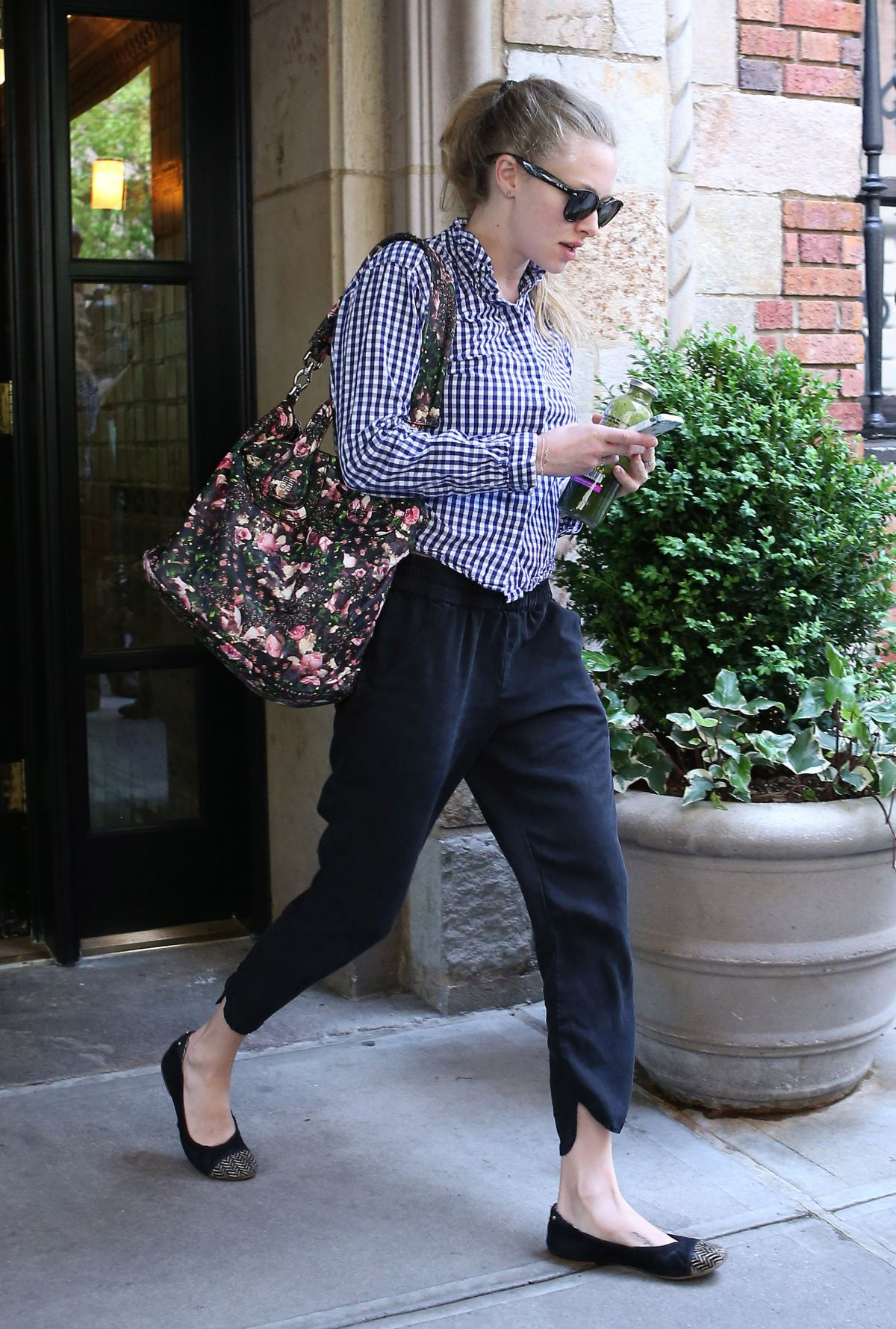 AMANDA SEYFRIED Leaves Her Apartment in New York