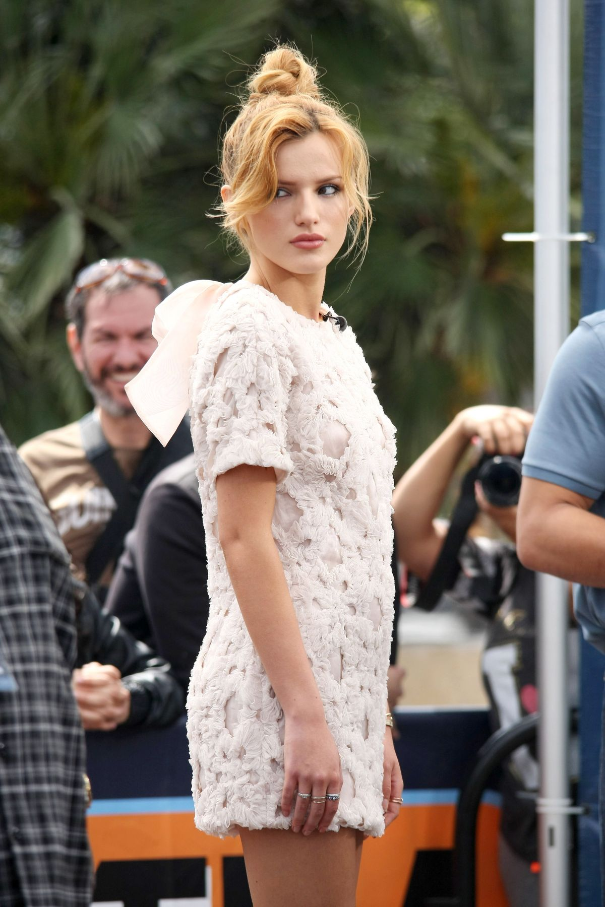 BELLA THORNE on the Set of Extra in Los Angeles