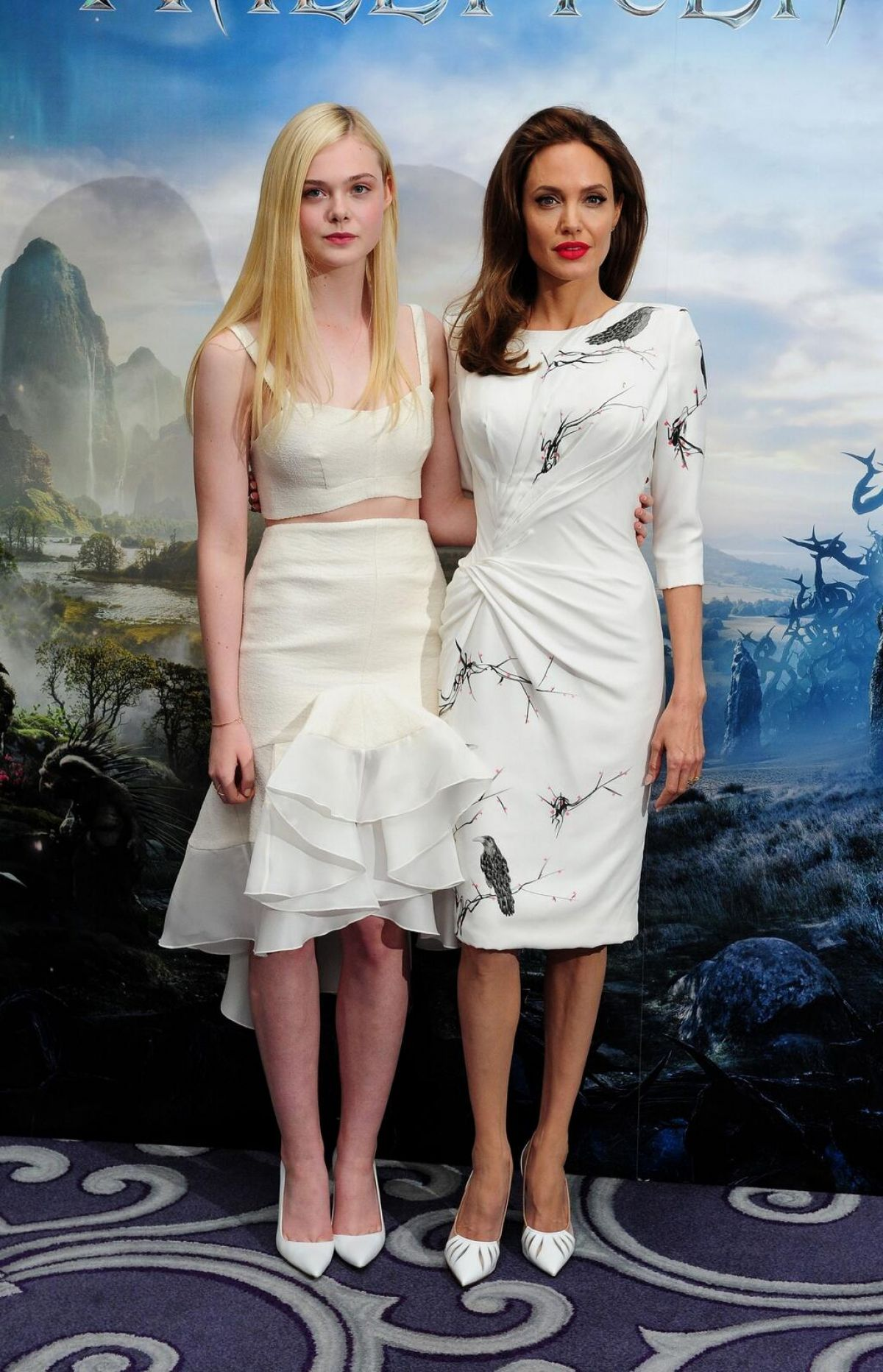 Elle fanning and angelina jolie at maleficient photocall in london