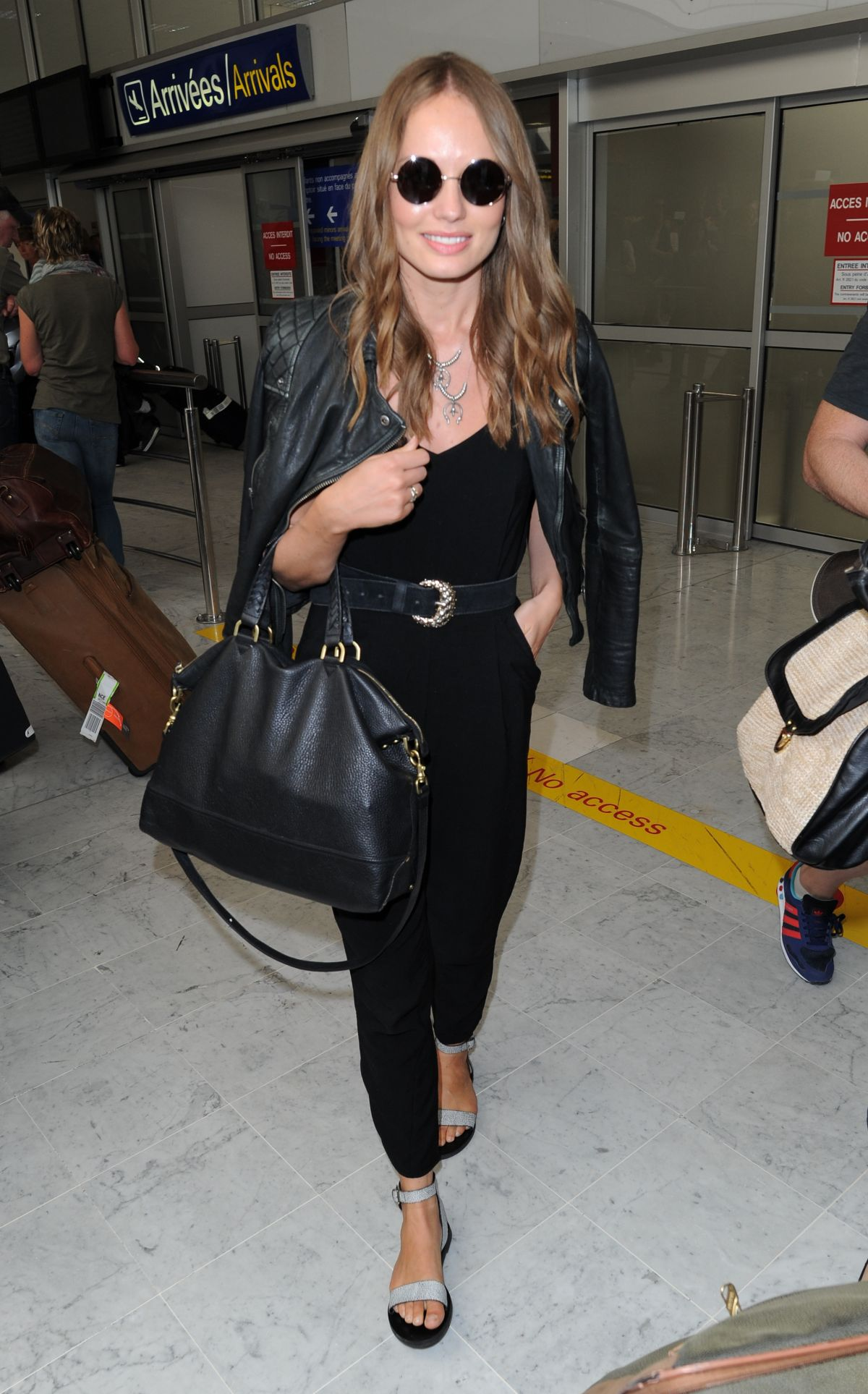LAURA HADDOCK Arrives at Airport in Nice